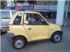 800px-Reva_Electric_Car_Side_2008.jpg